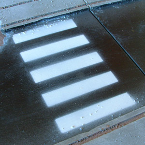 Close-up of a pedestrian crossing painted on the street